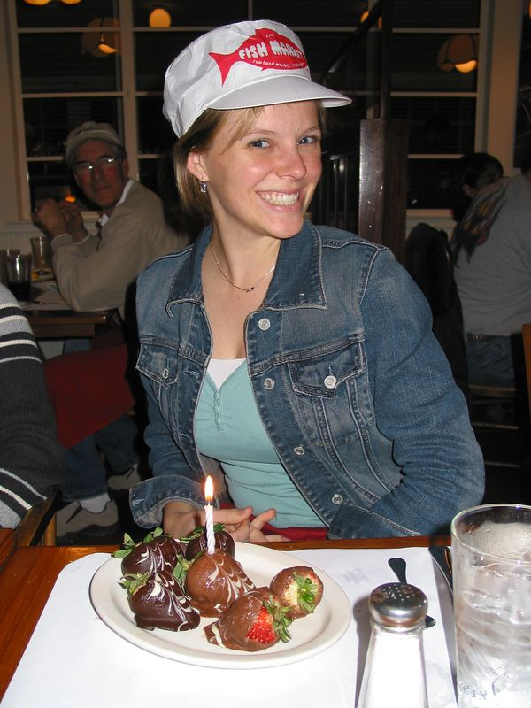 For my 23rd birthday, I chose to eat at the Fish Market where they have the best chocolate covered strawberries!  The singing waiters adorned me with a hat and a candle!
